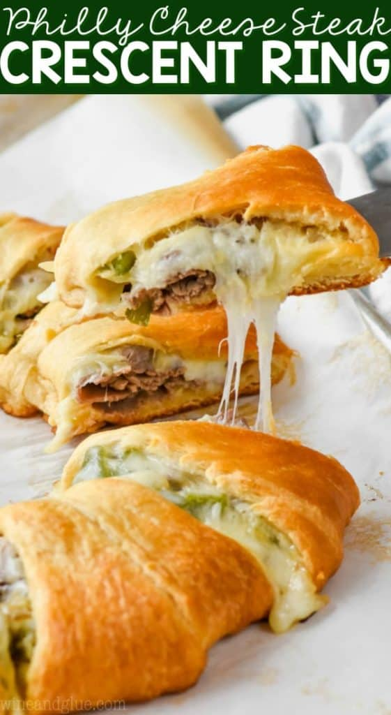 dishing out a piece of philly cheese steak crescent ring