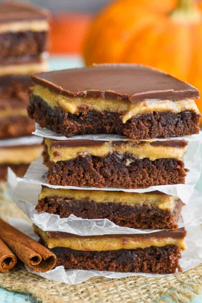 stack of the best pumpkin brownies showing the individual layers of brownie, pumpkin puree, and chocolate.
