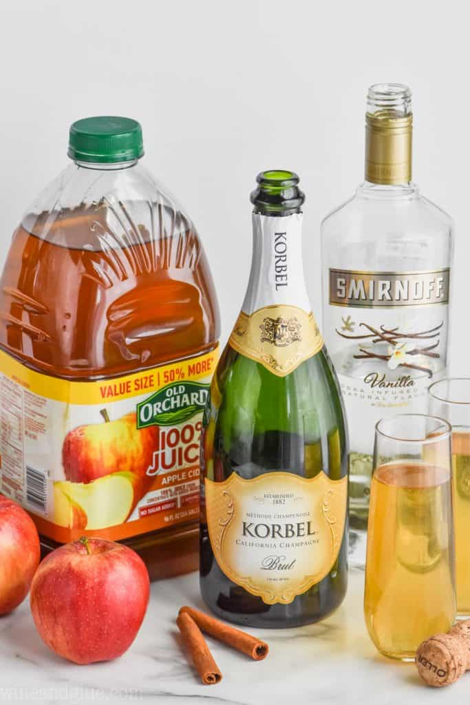 easy apple pie bellini drink recipe ingredients (Apple Juice, Champagne, and Vanilla Smirnoff).