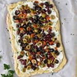 overhead view of black olive pizza recipe