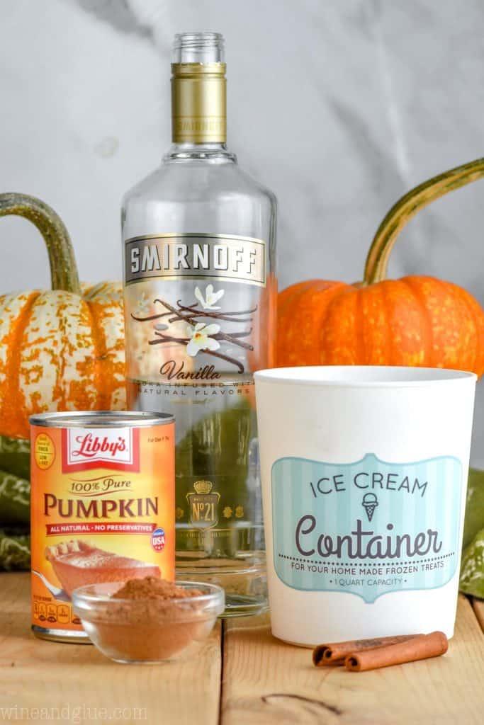 ingredients for a boozy pumpkin milkshake (pureed pumpkin, cinnamon, Vanilla Smirnoff, and ice cream)