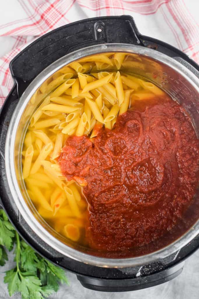 overhead view of pasta and spaghetti sauce in a pressure cooker