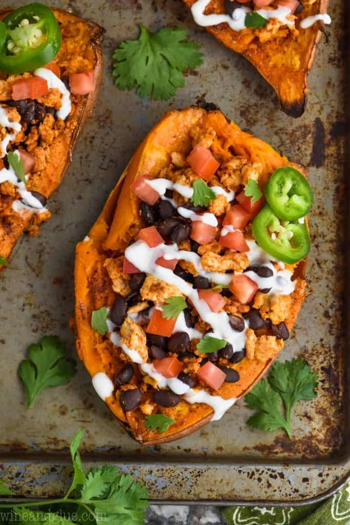 overhead view of mexican stuffed sweet potatoes recipe on a baking sheet