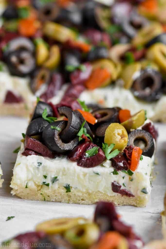 piece of olive pizza appetizer recipe garnished with parsley