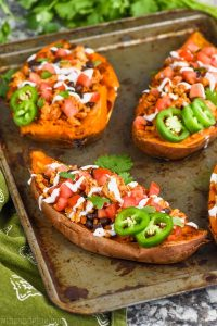 stuffed sweet potato recipe fixed like tacos on a baking sheet