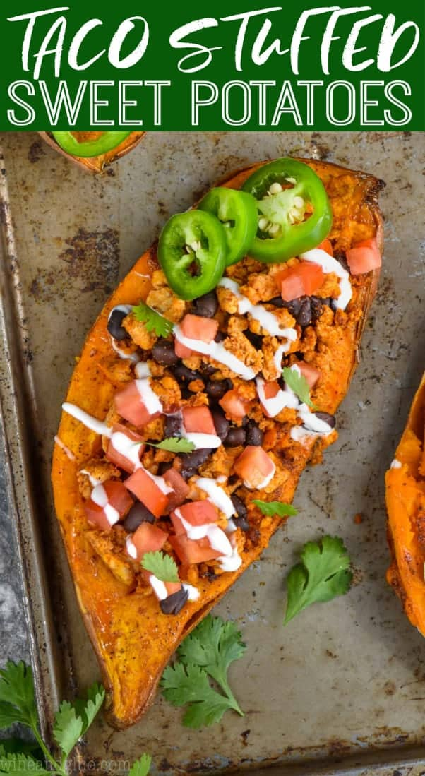 overhead view of taco stuffed sweet potato recipe topped with sour cream, jalapenos, and cilantro
