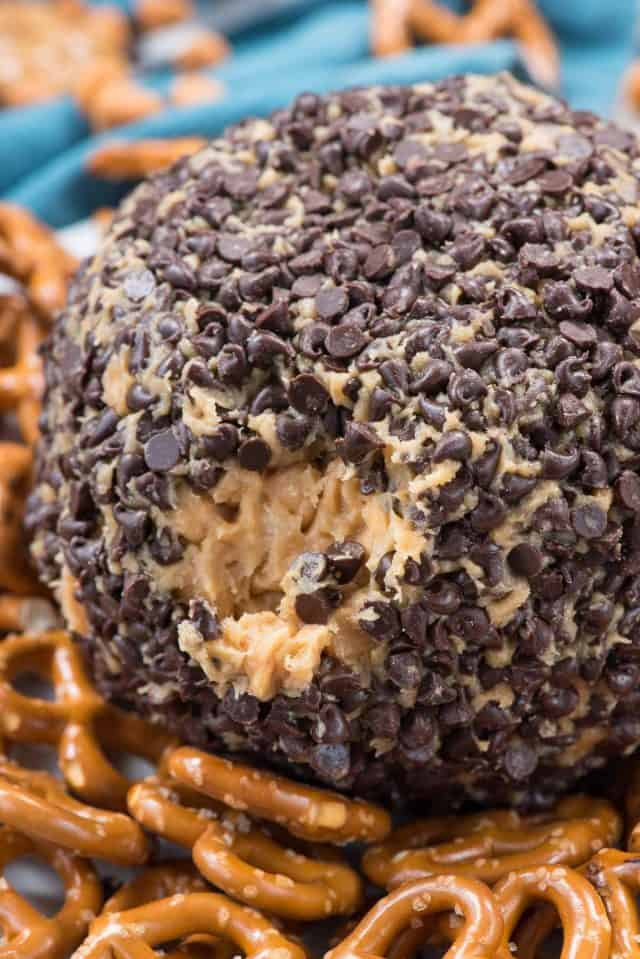 The Peanut Butter Cheese Ball Dip is surrounded by pretzels