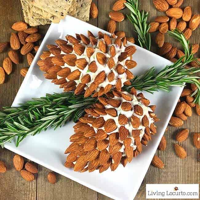 Two Pine Cone Cheese Ball with Almonds are on a square plate shaped as a pine cone with the help of the almonds