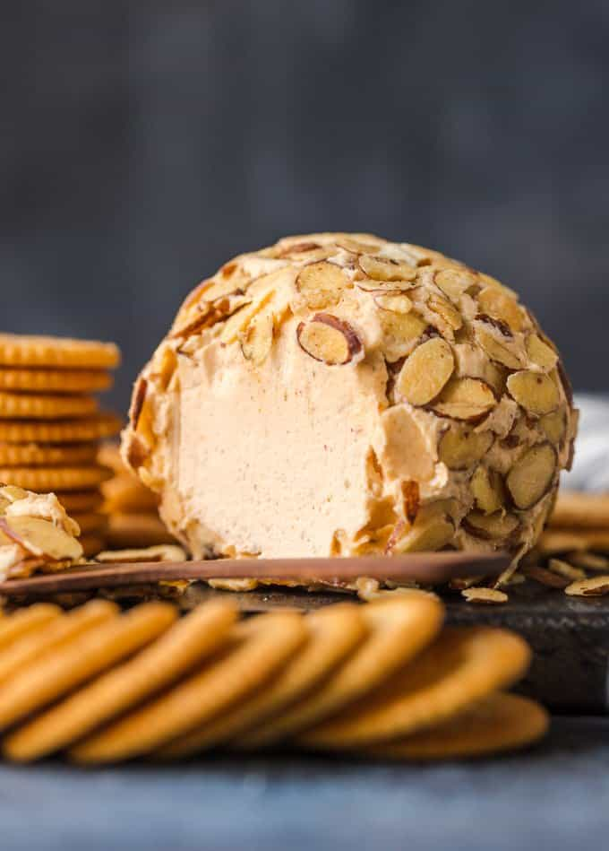 The classic cheese ball is topped with toasted almonds and surrounded by Ritz Crackers.