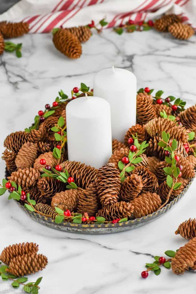 cinnamon scented pine cones on a tray to make a centerpiece