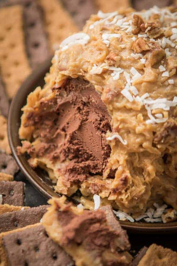 The German Chocolate Cake Cheese Ball has a sticky coconut crust surrounding it.