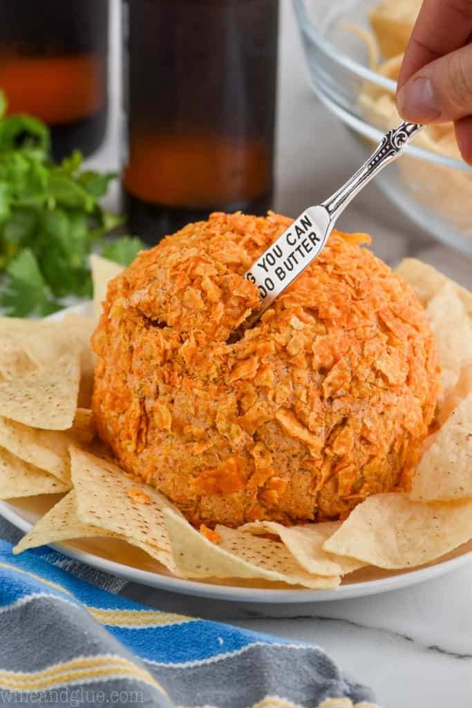 taco cheese ball with small knife sticking out of it for serving