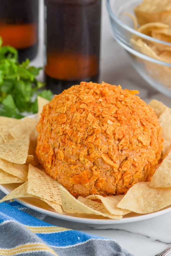 homemade cheese ball recipe on a plate with tortilla chips