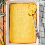 overhead of baked cream corn casserole in white casserole dish