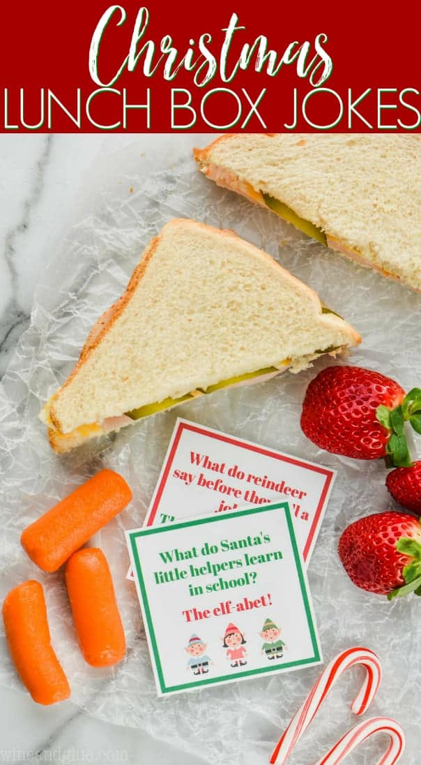 two christmas lunch box jokes with a sandwich, carrots, and strawberries
