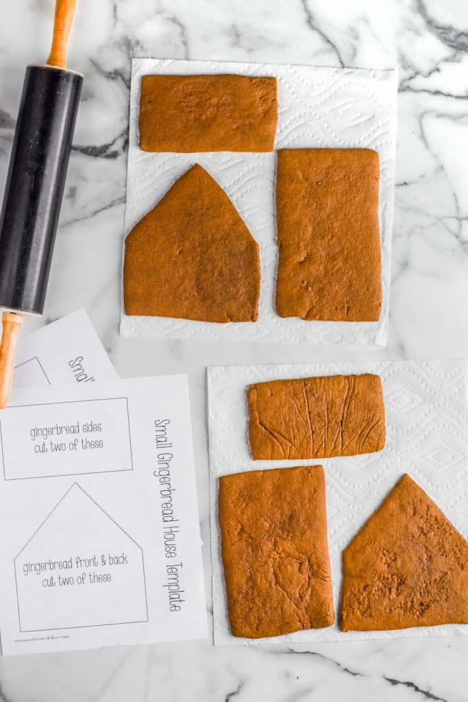 pieces of gingerbread house drying on paper towels