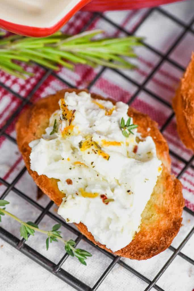 toasted baguette with goat cheese honey appetizer spread on it