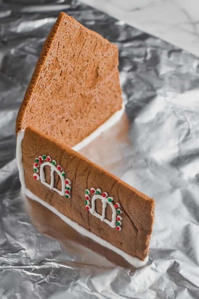 two pieces of gingerbread house standing up