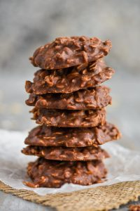 a stack of coconut chocolate peanut butter cookies
