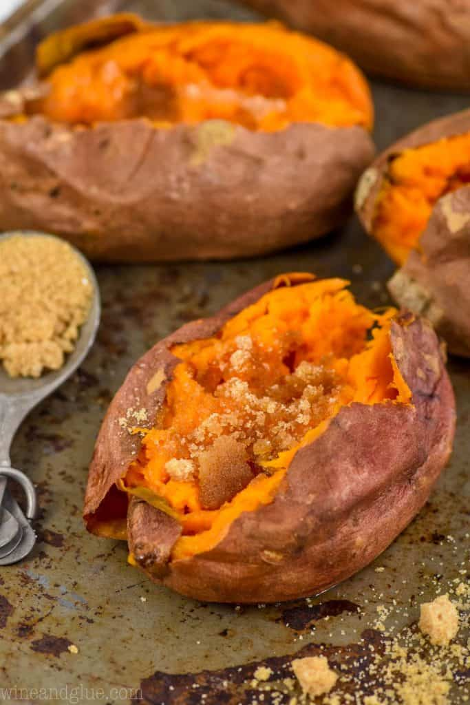 a crock pot sweet potato with brown sugar and butter on it