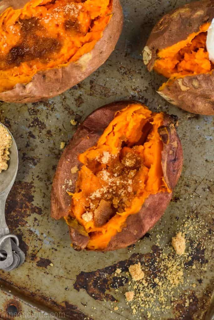 overhead view of a crock pot sweet potato cooked with butter and brown sugar on it