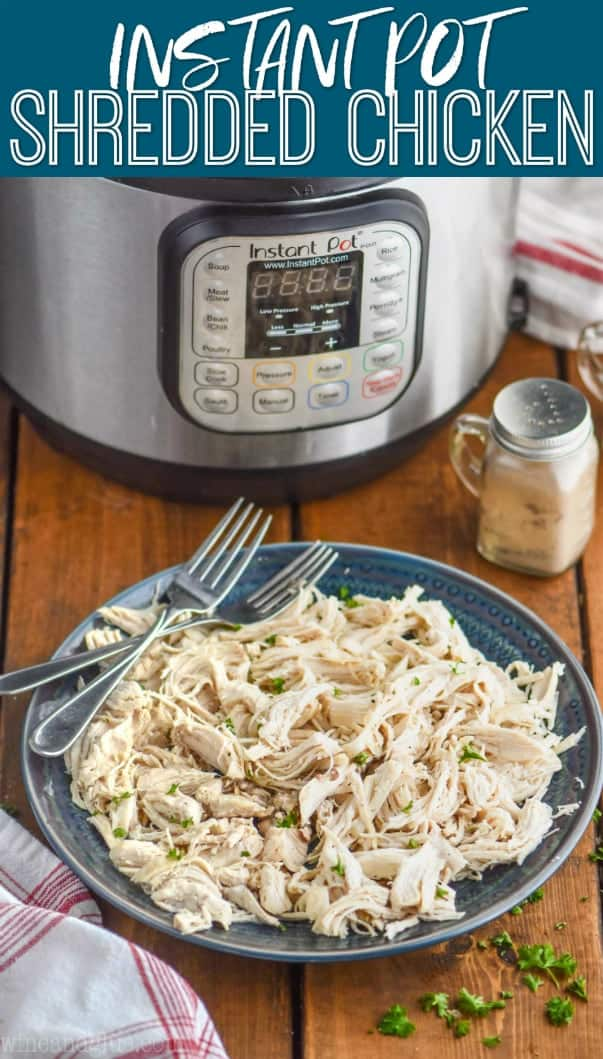 shredded instant pot chicken on a plate in front of an instant pot