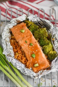 baked teriyaki salmon recipe with broccoli and rice in a foil packet