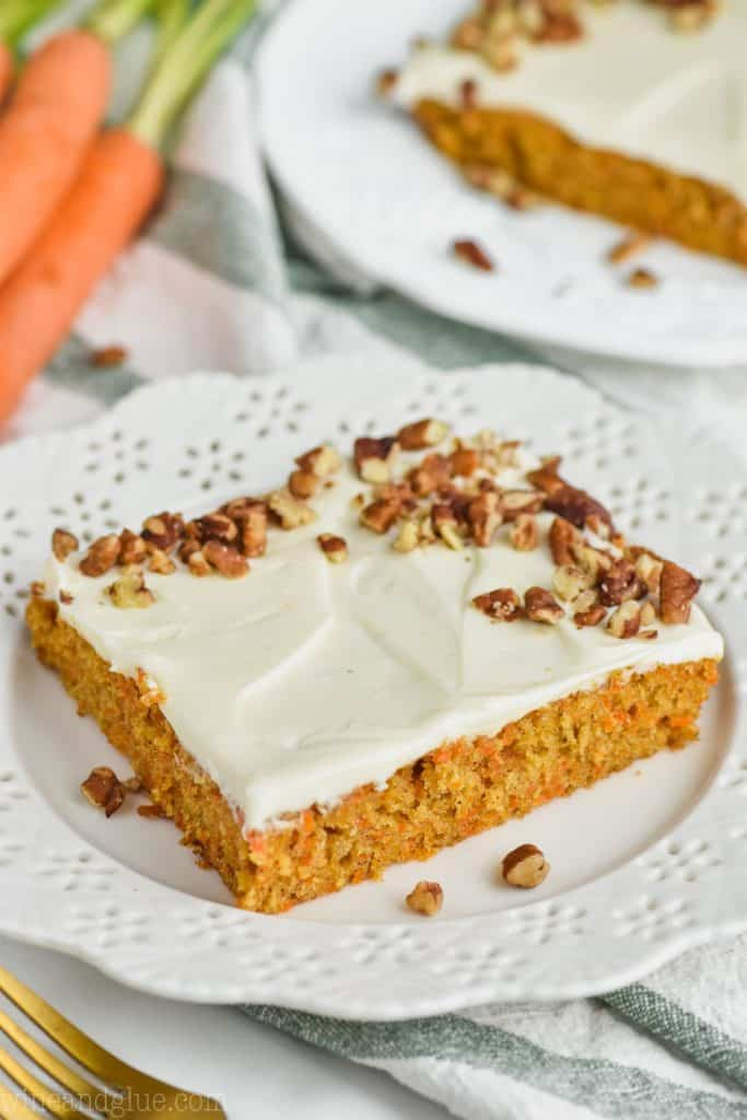 the best carrot cake recipe as a sheet cake on a white plate