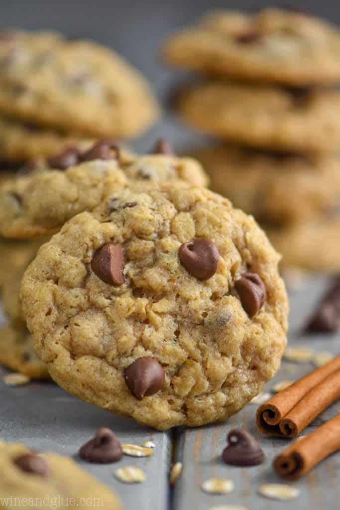 oatmeal chocolate chip cookie propped up against other cookies