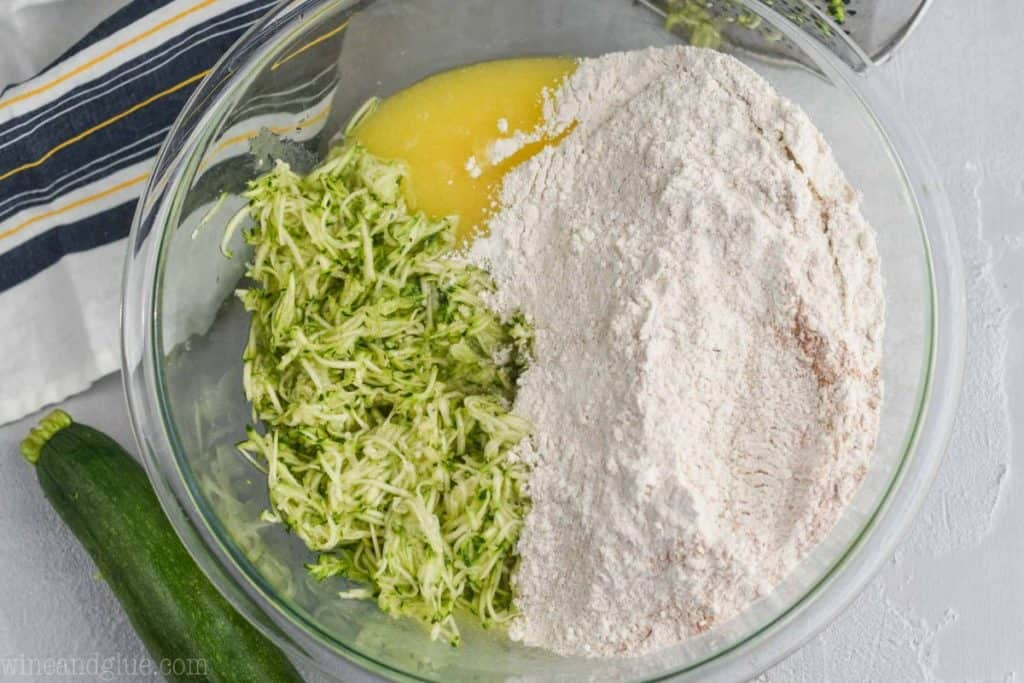 flour mixture with shredded zucchini, and oil and sugar mixture to make zucchini muffin recipe
