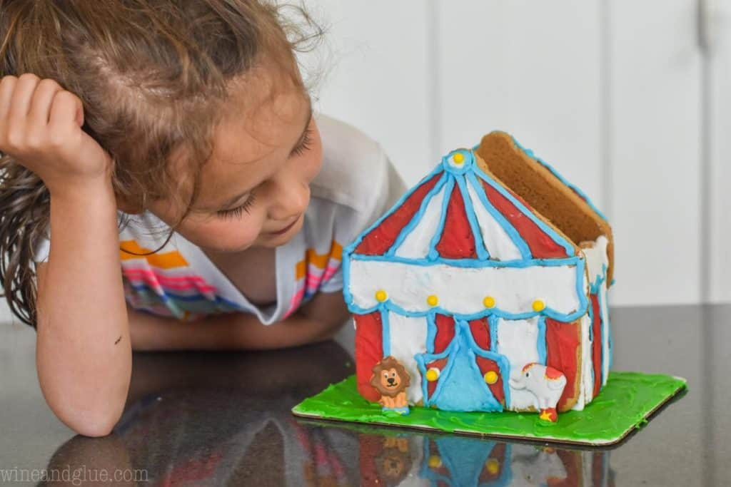little girl looking at 3-d circus tent cookie house