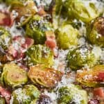 up close of roasted brussel sprouts with parmesan cheese and bacon