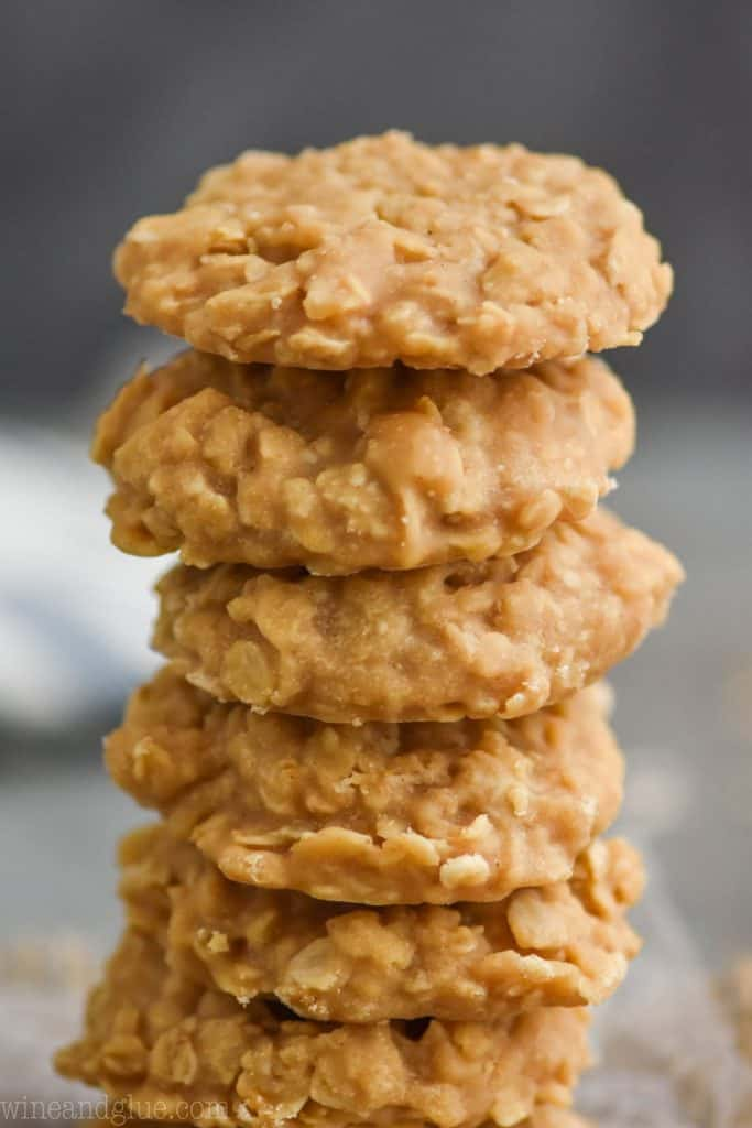 pile of six peanut butter no bake cookies, up close with a dark background