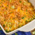 landscape photo of a white casserole dish with chicken broccoli cheese casserole