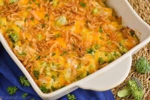 landscape photo of a white casserole dish with chicken broccoli cheese casserole
