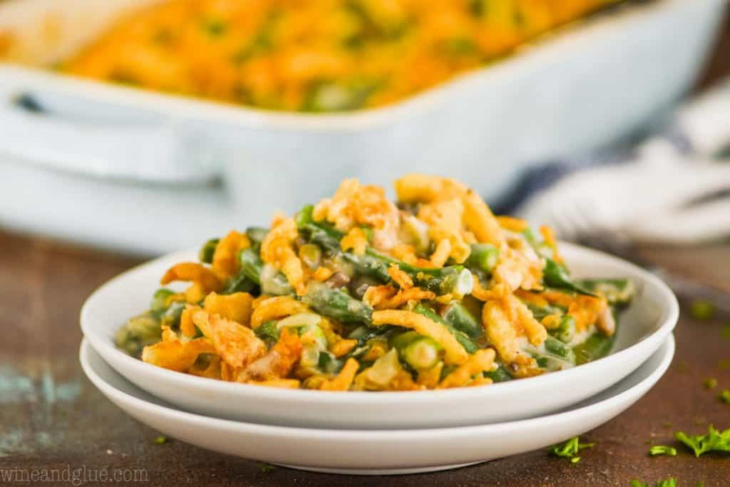 two white plates stacked topped with green bean casserole from scratch