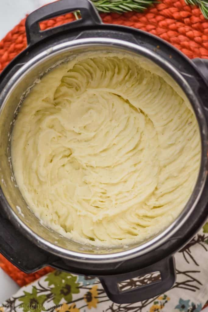 overhead picture of pressure cooker mashed potatoes blended up in the base of an instant pot
