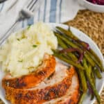 plate with turkey breast recipe, mashed potatoes, and green beans