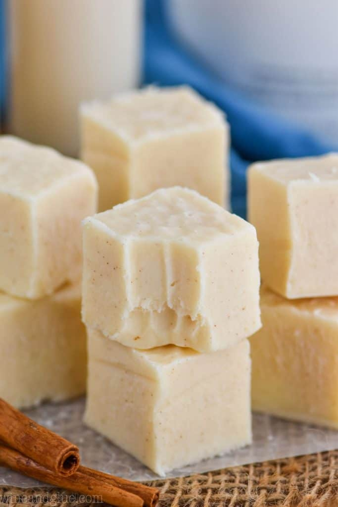 four stacks of rum Chata fudge, two pieces tall, the front one with a bite missing