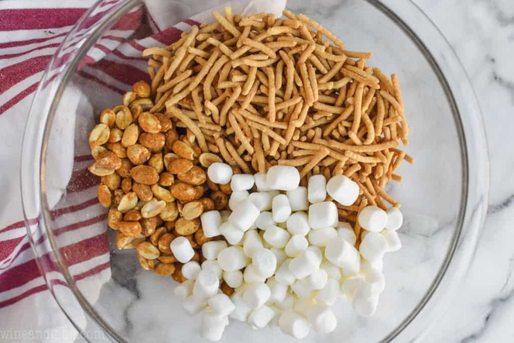 overhead view of bowl of peanuts, chow mien noodles, and marshmallows
