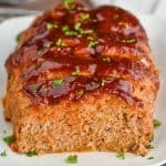 front view of a ground turkey meatloaf that has been sliced into and looks super moist