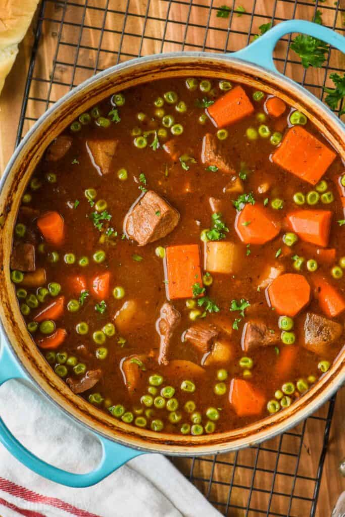 overhead view of a teal dutch oven holding beef stew