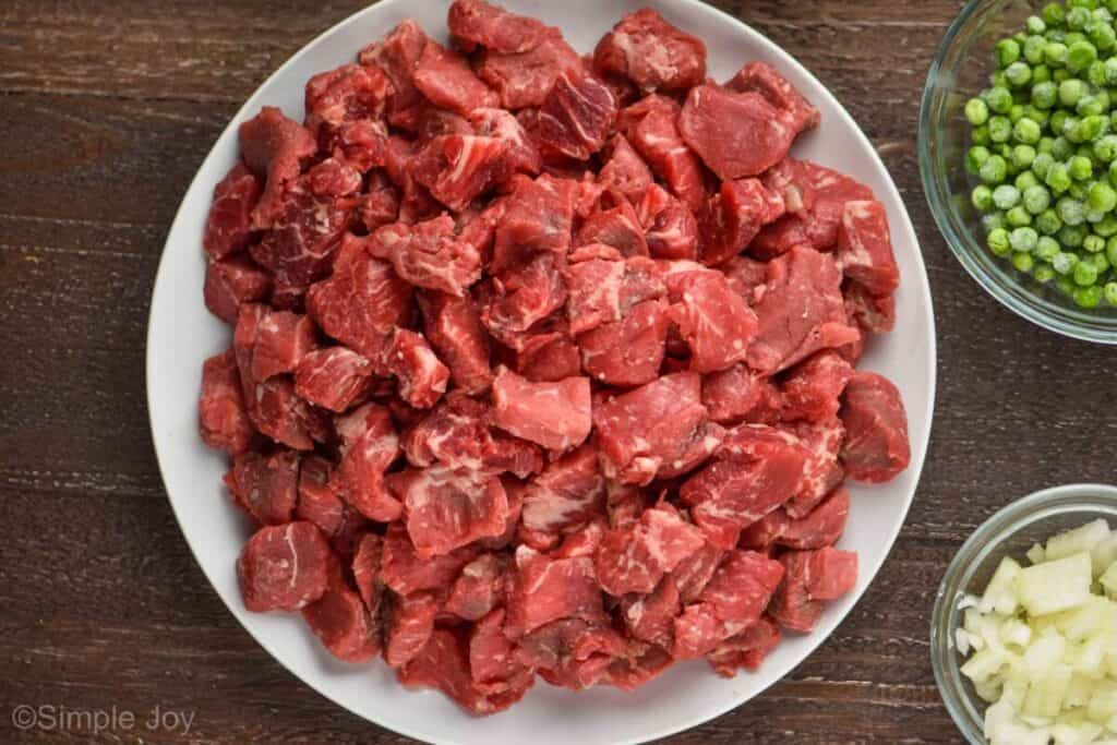overhead view of a white plate holding beef stew meat