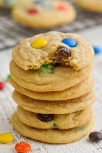 stack of six mm cookies with the top one missing a bite