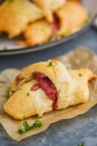 close up of a crescent roll made with corned beef to make it a reuben crescent roll