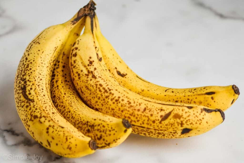 picture of a bunch of banana that are speckled brown and ready to be made into banana bread