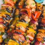 close up of chicken kabobs with graphics over the photo to tell the recipe title
