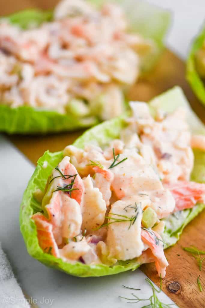 seafood salad in a lettuce cup garnished with fresh dill