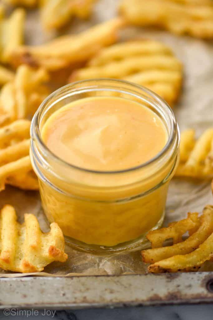 close up of a small mason jar holding Chick Fil A sauce