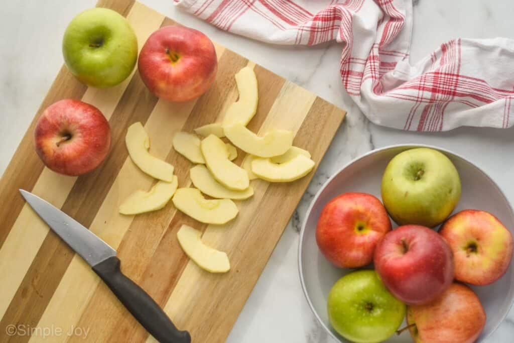 overhead photo of apples cut up on a cutting board